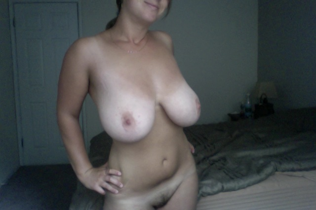horny girl on webcam showing off her big natural boobs